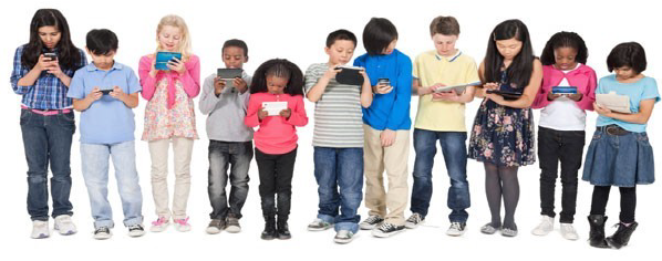 row of kids looking at multimedia devices