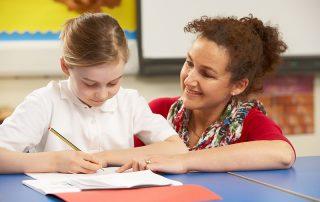 school girl studies with teacher